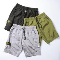 netzfutter großhandel-Neuer Laufsport Sport Shorts für kurze Hosen Nylon schnelltrocknend atmungsaktiv fünfhose Futter Mesh Kompass Stickerei Strandhose