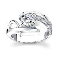 grandes anillos de diamantes de imitación para las mujeres al por mayor-Hueco de piedra grande de color plateado flor anillo de circonia cúbica para la moda femenina Popular Rhinestone anillos de boda para mujeres R125