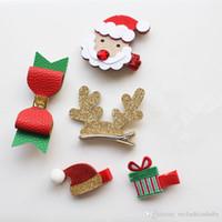 arcos de regalo rojo al por mayor-12 unids / lote PU lindo arcos de cuero Clip de pelo Fieltro de calidad superior de Navidad Forma de horquilla de regalo horquilla Headwear Santa Claus Red Hat Pin