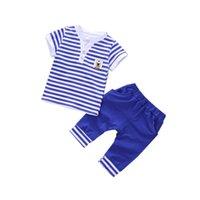 ingrosso vestiti di tweed delle neonate-Moda 2019 Estate Bambini Ragazzi Ragazza Vestiti a righe Bambino Breve T-shirt Pantaloni 2 pezzi / set Abbigliamento per bambini Imposta Tute da bambino