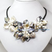 blüten süßwasserperlen großhandel-Unique Pearls jewellery Store, Gelbe Farbe Shell Echte Süßwasserperle Schwarzes Seil Leder Halskette Handgemachter Blumenschmuck