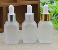 elastische glas-tropfflaschen großhandel-mattierte klare quadratische Glasflasche 10ml 20ml 30ml Mattglas-Tropfflasche mit goldsilber schwarzweißer Kappe für ätherische Öle