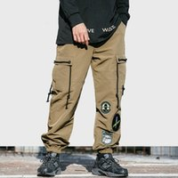 f91018b0e4 2019 Men Cargo Pant Streetwear Hip Hip Badge Patch Harajuku Pant Side  Pockets Ribbon Harem Pant Joggers Khaki Tactical Trousers