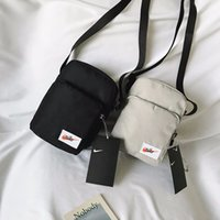 segeltuch-sling-taschen für männer großhandel-18x12x15 CM Nike Frauen Männer Leinwand Mini Cross Body Messenger Bag Sling Umhängetaschen Crossbody Shell Packs BA307