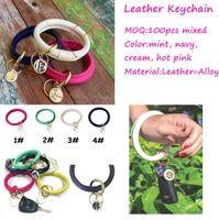 Wholesale monogram alloy resale online - 2019 New LARGE Pebble Leather Bracelet Keyring with Enamel Monogram Quatrefoil Disc O Key Ring Monogram Keychain Fob Loop Bangle big