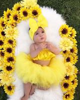 trajes de color amarillo al por mayor-Traje de falda de verano para bebé 3pcs / set con gran lazo Banda para el cabello y Top de tubo Falda de gasa corta para niños de color amarillo sólido Chica falda de diseñador Conjunto