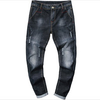 erkek pantolon yeni gelenler toptan satış-En Kaliteli Tasarımcı Erkekler Denim Jeans Ripped Pantolon Moda Pantolon Yeni Varış Erkek Kot Boyutu 28-38