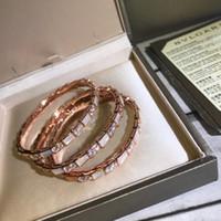 ingrosso braccialetto di diamanti del serpente-Braccialetto punk di vendita di disegno del serpente di vendita calda con il guscio bianco e diamante per il regalo di goccia di trasporto dei monili di cerimonia nuziale di marca delle donne il trasporto di goccia PS5402A