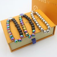 armbandkugeln großhandel-Heiße Verkaufs-Art- und Marke Benannt Armbänder Lady Pull-Typ Farbige Stahlkugel V Brief geschnitzte Blumen-Kettenarmbänder 3 Farbe