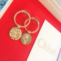 bronze ohrring bolzen großhandel-2019 Neue Damen Ohrringe charmante charismatische Göttin wesentliche elegante Palm Bronze Kreis asymmetrische Ohrringe