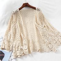 suéter de punto abierto blanco al por mayor-Cárdigan de encaje abierto Crocheted Hollow Out Shrug Mujer Casual Flor blanca Floral Puntada abierta Suéter de mujer Outwear de punto suelto