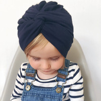 Wholesale skull cap cross for sale - Group buy newborn cross hat baby Turban Knot Beanie children s cap solid color pullover hats Toddler photography props Cap AAA1810