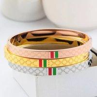 g strip achat en gros de-19CM Top Qualité titane bijoux en acier en gros G lettre plaid rouge vert goutte huile bande horizontale dames ovale bracelet