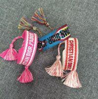 materiais para costura venda por atacado-Venda quente corda colorida material Corda Infinito símbolo Sorte Cord Pulseira Ajustável com palavras de costura e borla transporte da gota