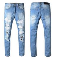 cool hip hop calças venda por atacado-Mens Designer Calças Skinny Rasgado Hip Hop Moda Calças Fresco Mens Jeans Designer Jumpsuit Mens Jeans