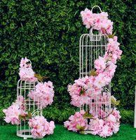 blumenschmuck kirsche großhandel-Kirschblüte Reben Weiß Rot Rosa Künstliche Seidenblume Reben Wandbehang Glyzinien Hausgarten und Hochzeit Dekorationen 177 cm