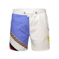 secadora de aire al por mayor-Pantalones cortos de moda para hombre Verano 2019 Secado rápido Air permeable Cordón Pantalones cortos deportivos Huella Verano Beach Men Cloth # 6912