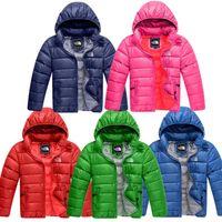 diseño para tops de algodon al por mayor-Escudo de los niños de invierno acolchado niños del diseño de marca NF algodón abajo de la chaqueta del Norte junior muchachas del muchacho encapuchado Outwear Cara Ligera Tops C120401