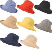 sombrero de cubo liso al por mayor-Playa de verano de ala ancha pescador Sombrero anti-ultravioleta sun bob cap Mujeres HOMBRES Fashion Plain Bucket Hat