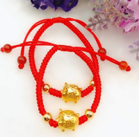 chinesisches rotes seilarmband großhandel-Gold überzogenes glückliches Schwein-Charme-rotes Seil-Tierarmband chinesischer Feng Shui Maskottchen-Schmuck