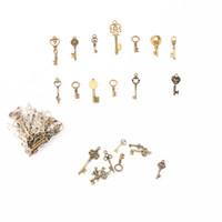 antike herz schlüssel anhänger großhandel-Antike Vintage Bronze farbe Schlüssel Anhänger Alte Bronze Skeleton Keys Phantasie Herz Bogen Halskette Anhänger Charms DIY, die Entdeckungen