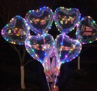 led yıldızlı şekilli ışıklar toptan satış-Aşk Kalp Yıldız Şekli Yanıp Sönen LED Işık Bobo Balonlar Aydınlık Şeffaf Balon Noel Düğün Dekor için Sopa ile SN1717