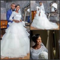 Wholesale custom made wedding dresses nigeria resale online - 2019 New Nigeria Wedding Dresses Jewel Neck Long Sleeves Lace Bridal Gowns Tiered Skirts Beach Boho Wedding Dress Plus Size