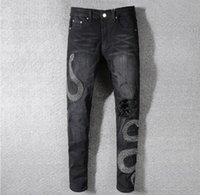 ingrosso jeans ricchi-Mens Distintivo serpente nero Jeans aderenti neri Fashion Designer Distressed Slim Fit Motociclista Foro Beggar Hip Hop Denim Pants 567