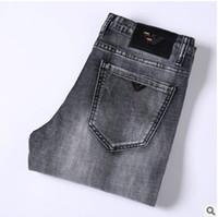 горячие дизайнерские джинсы оптовых-Горячие Продажи Мужские Дизайнерские Джинсы тонкие эластичные узкие джинсы мужские прямые брюки Slim Cowboy Известные классические джинсы