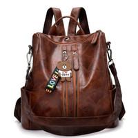 bolsa de lona para hombre al por mayor-Diseñador- Mochila de mujer vintage Mochilas de cuero de alta calidad para mujeres y jóvenes para adolescentes Bolso de hombro femenino de la escuela Mochila Mochila