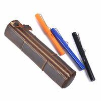 bolígrafos hechos a mano lápices al por mayor-Cremallera de cuero genuino caja de lápiz hecho a mano creativo bolsa de almacenamiento de la bolsa de la pluma Vintage Kawaii School Stationary Products T8190621