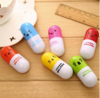 Wholesale pills shaped pen resale online - Pill Shape Retractable Ball Point Pen Rollerball Pens Creative Stationery Students Children s Gifts DHL