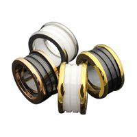 anillo de cerámica de moda al por mayor-316L Titanio Acero Chapado en Oro Rosa Anillo de Engranaje para Parejas Negro / Blanco Anillo de Cerámica Diseñador Retro joyería de moda para mujeres