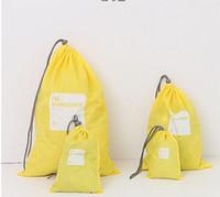 roupa de grife grátis venda por atacado-Envio Designer-Free Japan Travel armazenamento de roupas impermeáveis Shoes Nylon Bundle Bag 4pcs saco listrado