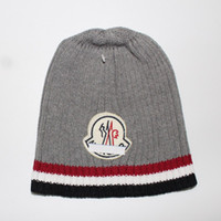 Wholesale brand beanies hats online - Hot Mon Brand Unisex Winter Knitted Caps Men and Women Warm Crochet Caps Fashion knitting couple Casual Beanie skullies Caps