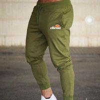joggeurs de musculation achat en gros de-Pantalons de jogging pour hommes Pantalons décontractés Fitness Pantalons de survêtement skinny Pantalons Pantalons de survêtement noirs