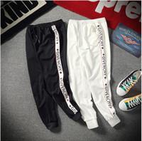 xl kadınlar için harem pantolonu toptan satış-2019 tasarımcı dize Logosu erkek kadın Joggers Rahat Harem Sweatpants spor pantolon Moda erkek baskı Hareket Pantolon