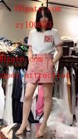 beyaz pembe elbise kısa toptan satış-2019 yaz elbise kadın Eşofman Beyaz baskılı kısa kollu T-Shirt + Pembe baskılı etek kadın 2 adet suit Yüksek kalite kadın giyim BC-2