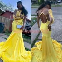 plumas de vestidos amarillos al por mayor-Hermosos vestidos de fiesta de encaje de sirena amarilla 2019 Pluma hueca pura fiesta africana formal Vestidos de noche de niña negra Vestidos de invitados Robe De Soiree