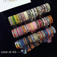braceletes de corda para mulheres venda por atacado-Atacado pulseira estilo clássico tecido mão cordas letras bordados para homens e mulheres tecido corda dupla pulseira 43 cor