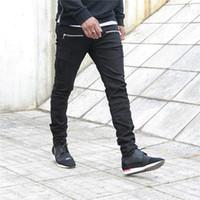 rapazes jeans estilo europeu venda por atacado-Moda nova rocha jeans Renaissance europeus e americanos meninos estilo de rua jeans rasgados homens