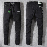 ingrosso pantaloni di jeans strappati-Jeans strappati strappati strappati da uomo Designer di moda Shorts Jeans Slim Motociclista da moto Motociclista Causale Pantaloni uomo denim Hip Hop Uomo Jeans # 658
