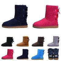 botas de piel de invierno de lujo al por mayor-UGG Nuevas botas de diseñador Australia mujer niña botas de nieve clásicas de lujo bowtie tobillo Botas de piel de medio arco invierno negro Castaño talla 36-41