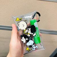 snoopy pvc al por mayor-Venta caliente INS Snoopy Charlie bolsa de lápiz pequeña de PVC transparente bolsa de almacenamiento de bolsillo Kawaii paquete de tarjeta de monedero herramienta de almacenamiento de aprendizaje