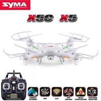 actualizar x5c camara al por mayor-Syma X5c (versión de actualización) Rc Drone 6 ejes control remoto helicóptero Quadcopter con cámara de 2mp Hd o X5 Rc Dron Sin cámara T190621