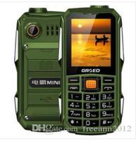 cuádruple stock de teléfono al por mayor-Hotsale Mini campo militar campo tres pruebas teléfonos móviles GSM 6800mha Espera súper larga Portugues Francés Español Inglés Ruso