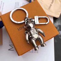 llavero de marca al por mayor-Marca nueva moda marca llavero aleación astronauta diseño lujo coche llavero moda marca bolso accesorios