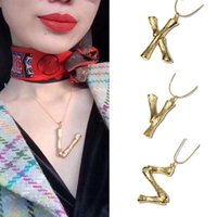 Wholesale bone style chain for sale - Group buy European and American Street style English Letter Bamboo Pendant Snake Bone Necklace English alphabet golden necklace box
