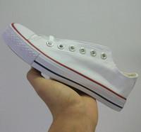 marcas de zapatos casuales para hombre al por mayor-¡Precio promocional a estrenar de la fábrica! Zapatos de lona para mujeres y hombres Zapatos de lona clásicos de estilo bajo Zapato de lona informal