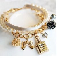 gold bogen charme armband großhandel-2018 heiße Neue Mode Dekorative Parfümflaschen Leder Simulierte Perle Bogen Charme Perlen Armreifen Armbänder Für Frauen Schmuck